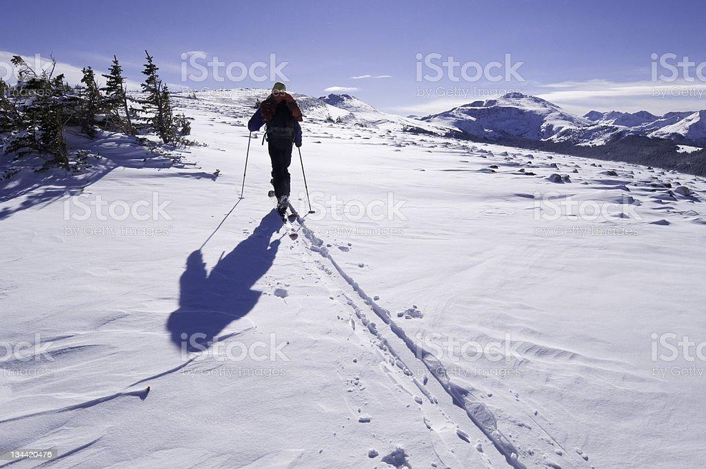 Lone Man on Ridge Ski Touring in the Mountains royalty-free stock photo