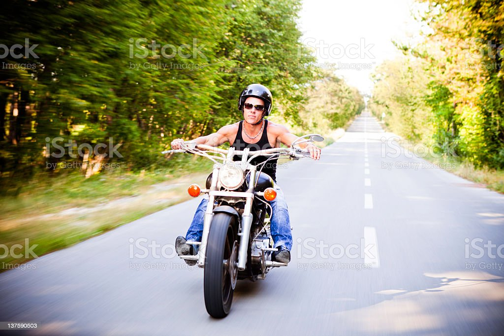 Lone motorbike rider in the countryside stock photo