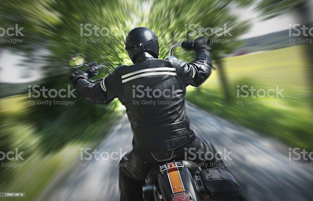 Lone motorbike rider stock photo