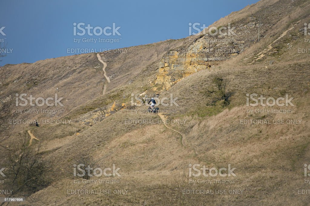 Lone Mountain Biker on Cleeve Hill in Gloucestershire, England stock photo