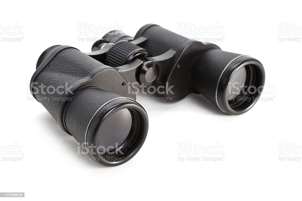 A lone pair of black binoculars on a white background stock photo