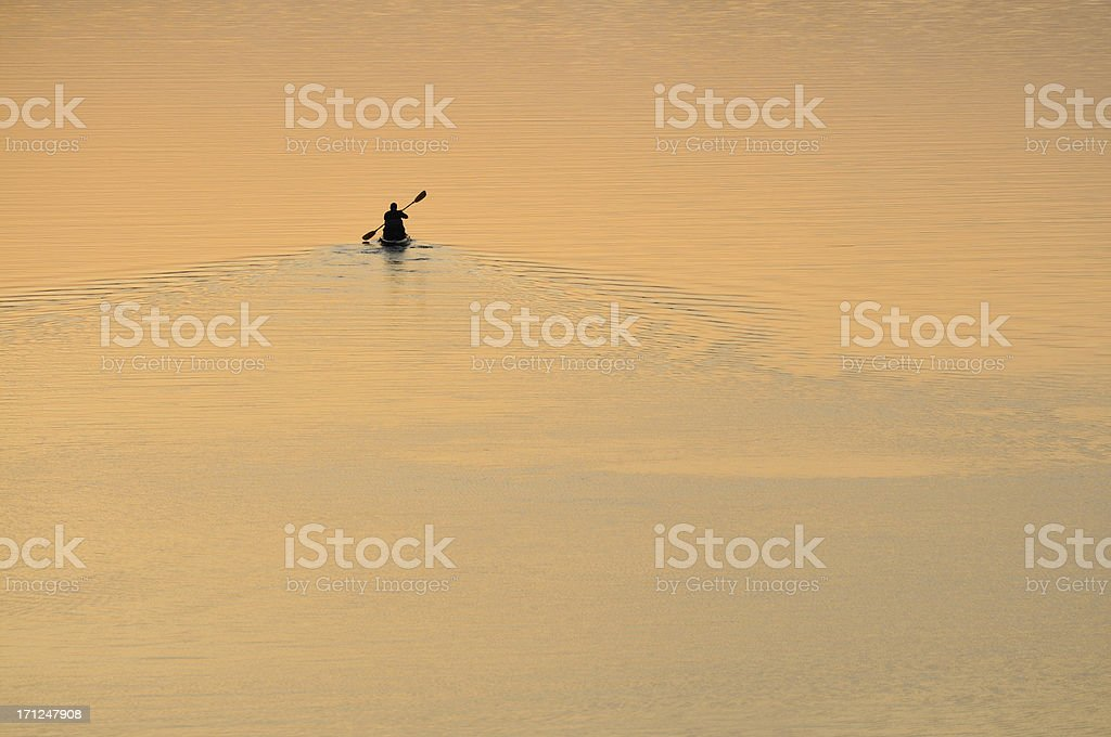 Lone Person Canoeing on Lake stock photo