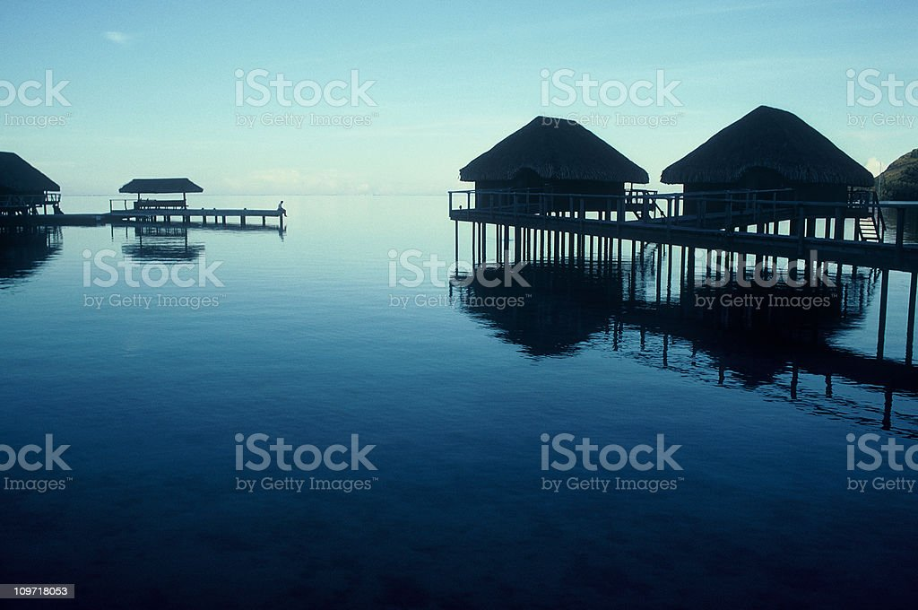 Lone Person Standing on Pier in Tropical Resort royalty-free stock photo