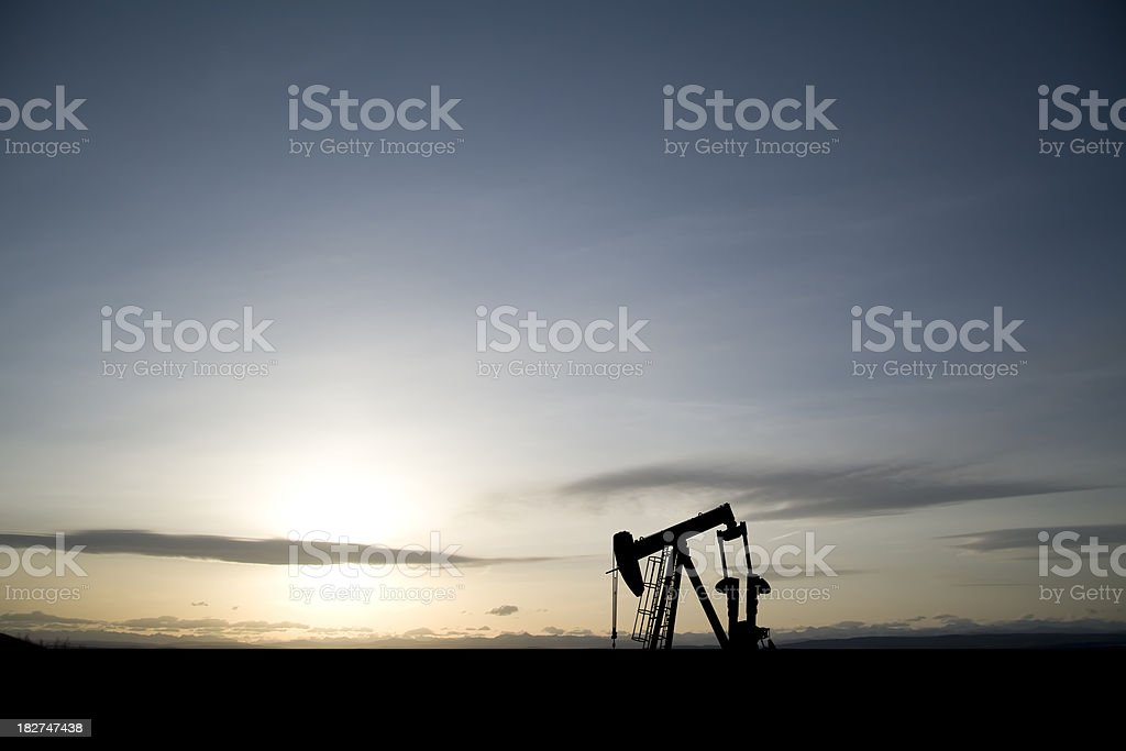 Lone Pumpjack at Dawn stock photo