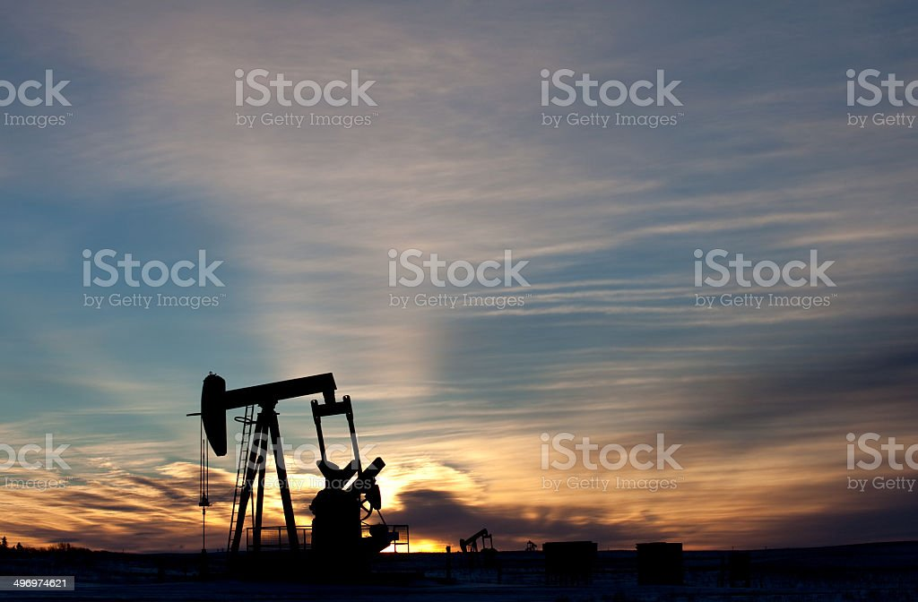Lone Pumpjack Silhouette in Texas stock photo