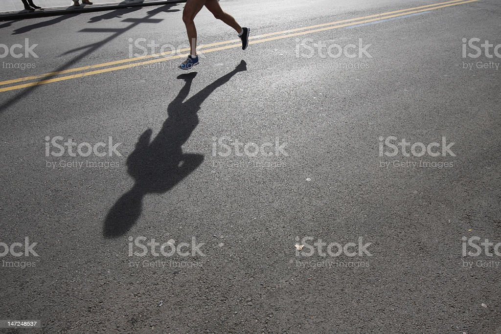 Lone runner in the street stock photo