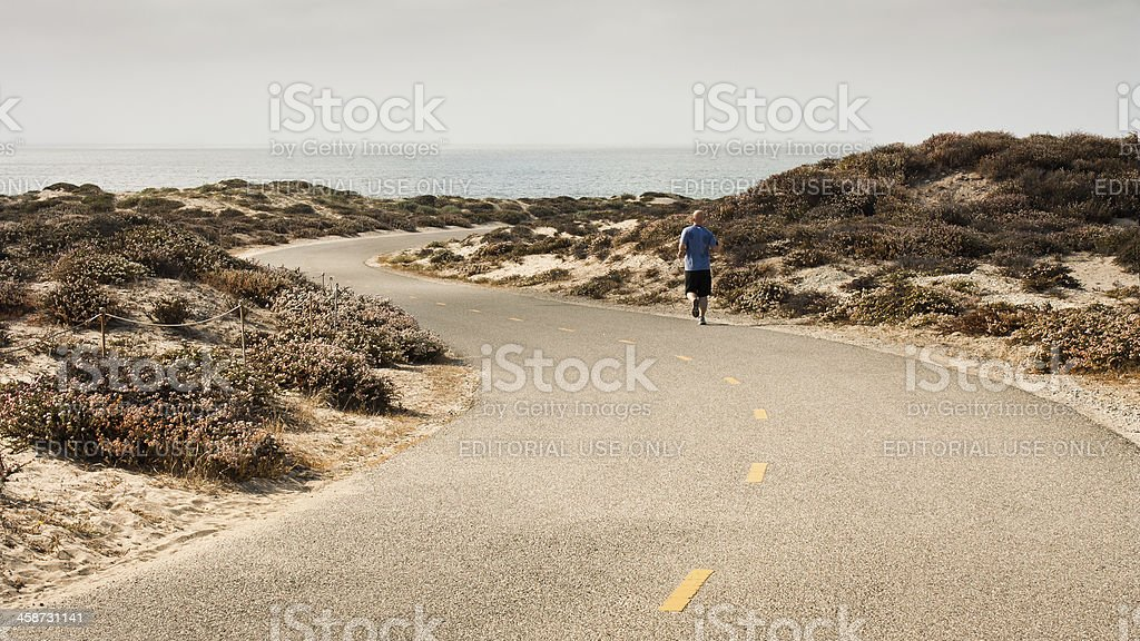 Lone Runner on Recreation Trail royalty-free stock photo