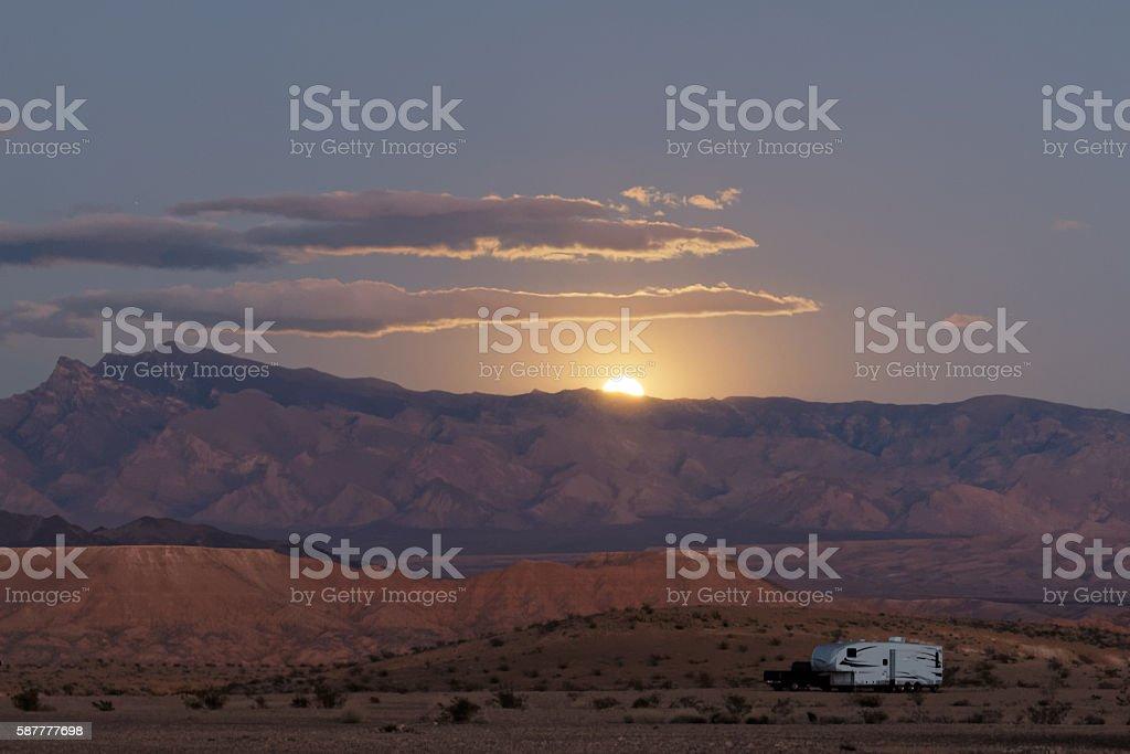 lone rv in desert sunset stock photo