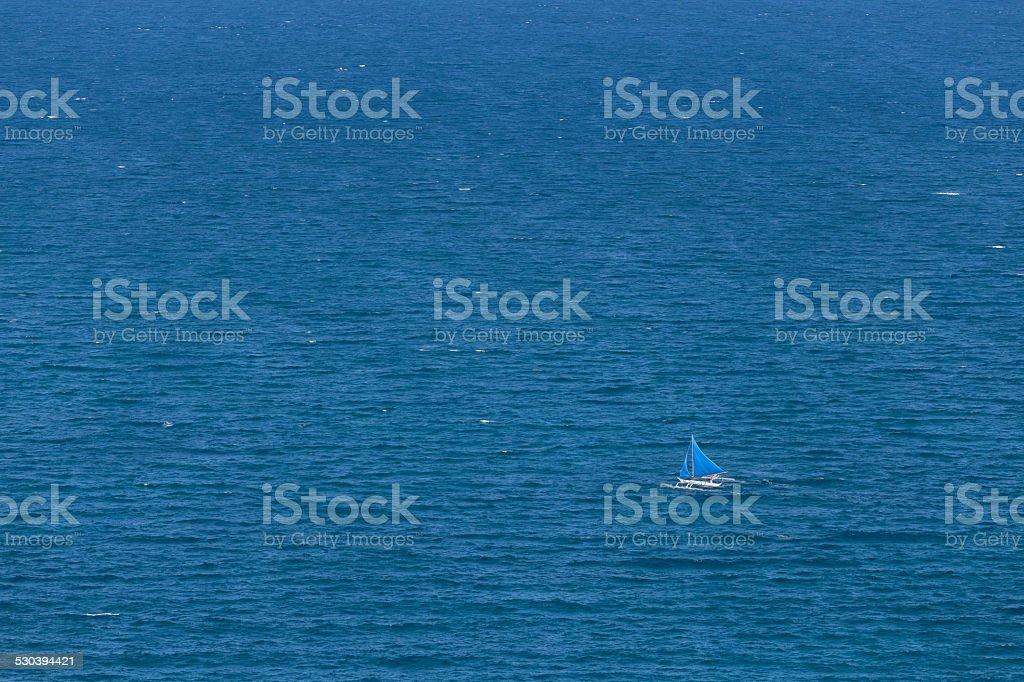 Lone sail on the high seas stock photo