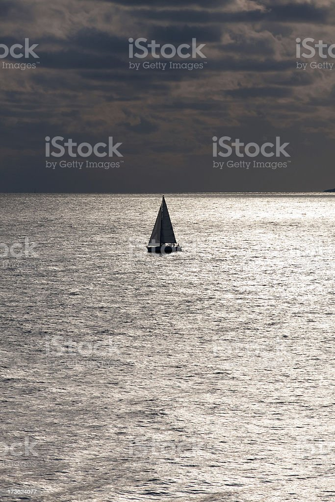 Lone sailboat in winter sea royalty-free stock photo