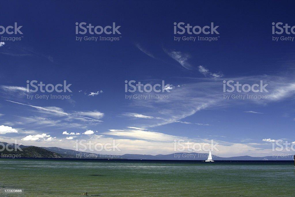 Lone sailboat on Lake Tahoe royalty-free stock photo