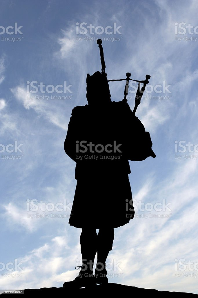 Lone Scottish Bagpiper stock photo