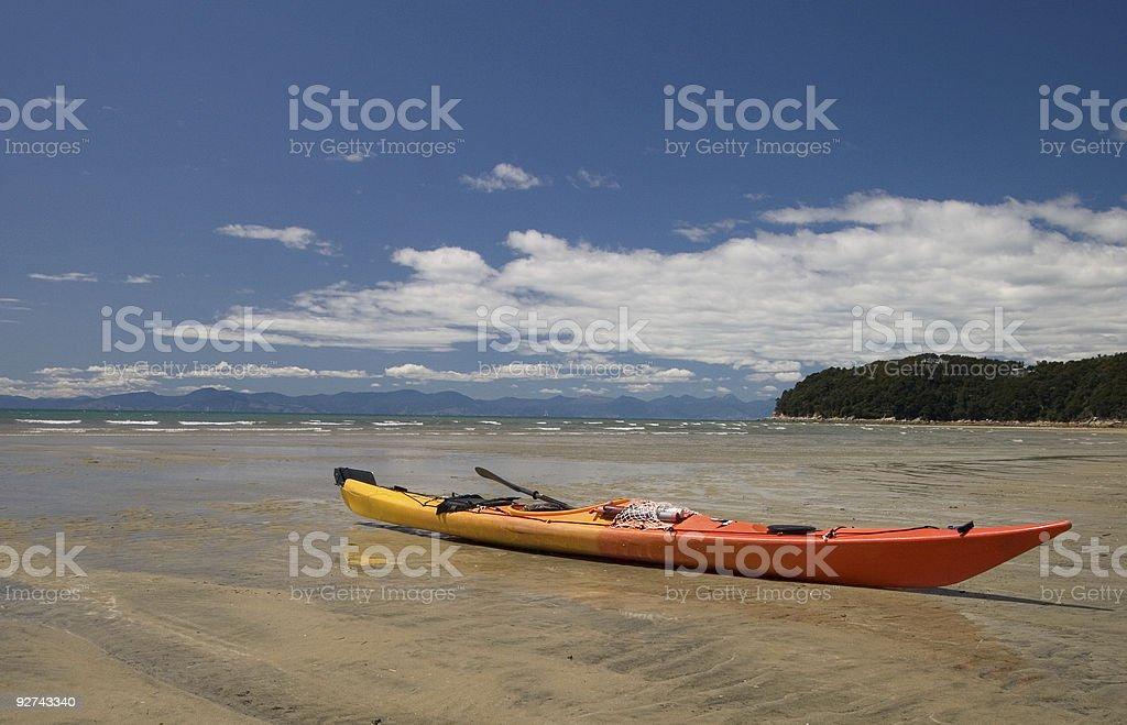 Lone sea kayak on beach in South Island, NZ royalty-free stock photo