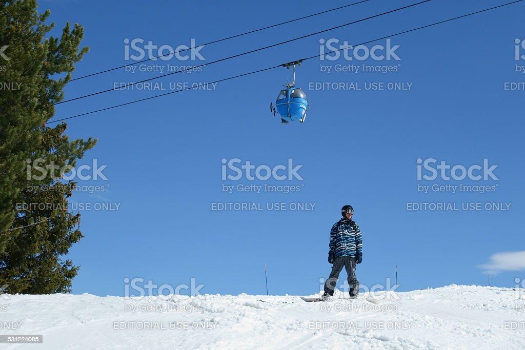 Lone snowboarder stock photo