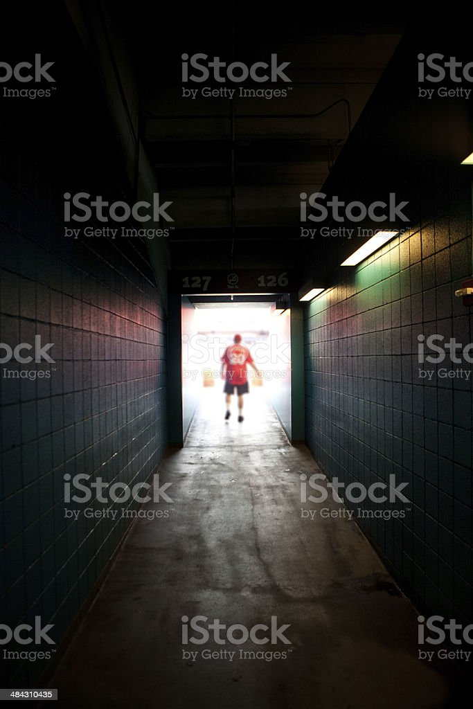 Lone sports fan waiting on game stock photo