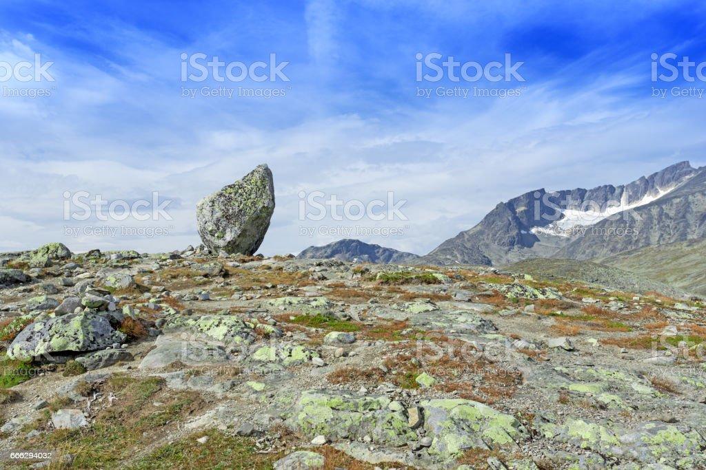 Lone standing rock at Besseggen Ridge stock photo
