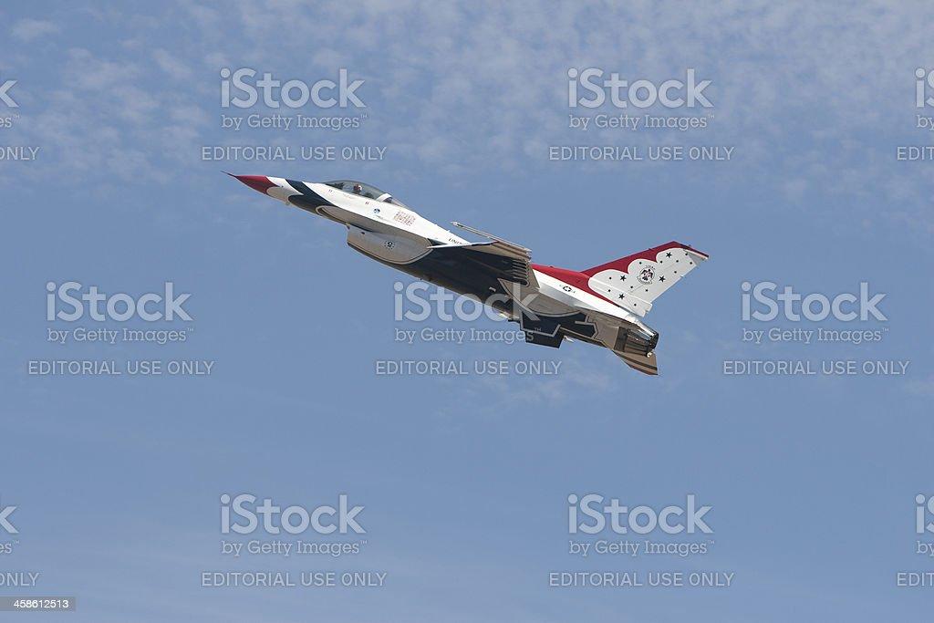 Lone Thunderbird F-16 military jet airborne royalty-free stock photo