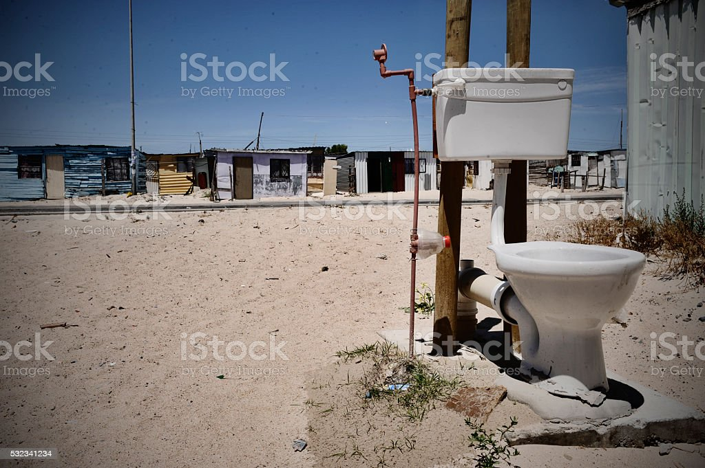 Lone toilet exposed in squatter camp stock photo