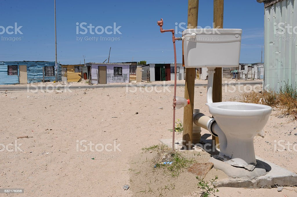 Lone toilet with sandy background squatter camp stock photo