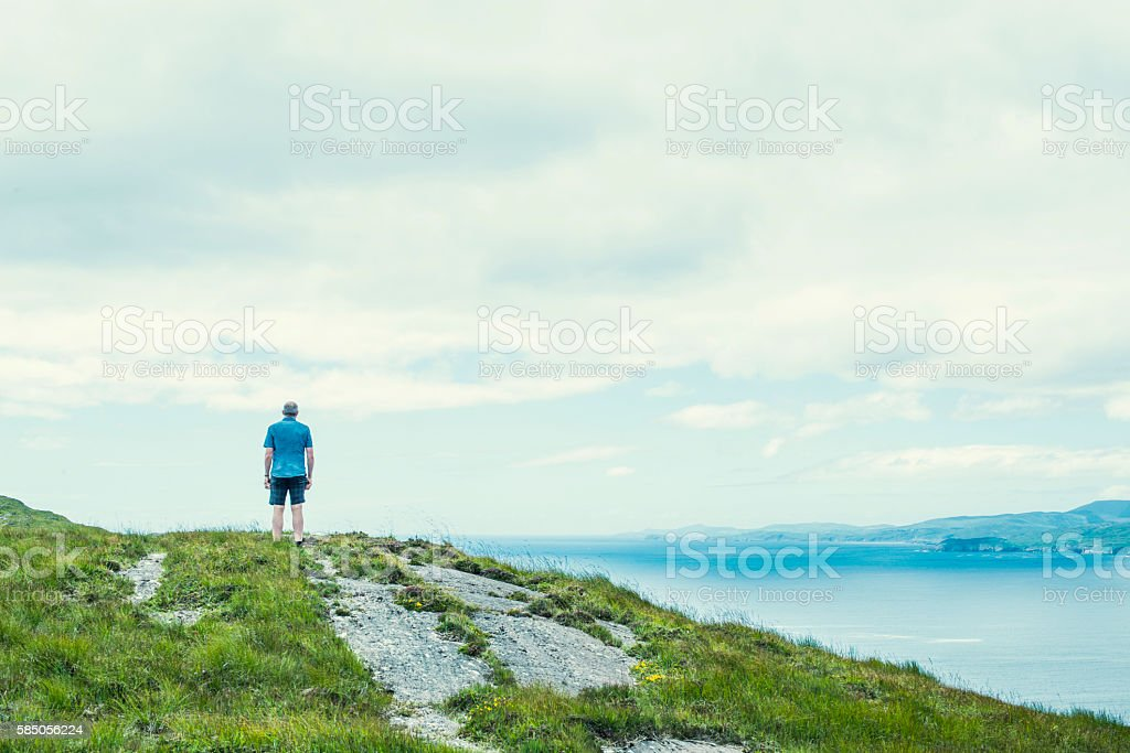 Lone traveller on Sheep's Head, Co. Cork, Ireland. stock photo