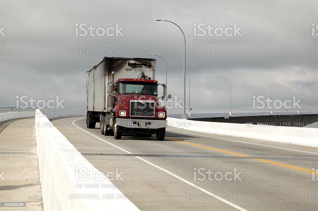 Lone trucker on high rise bridge stock photo