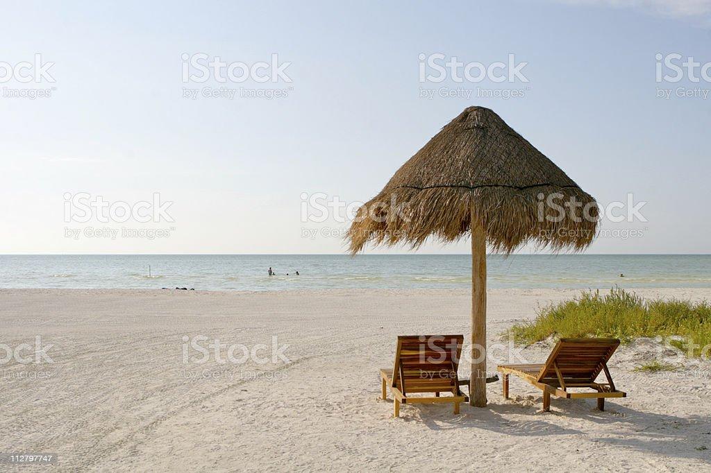 Lone Umbrella Beach Paradise Summer Caribbean Getaway royalty-free stock photo