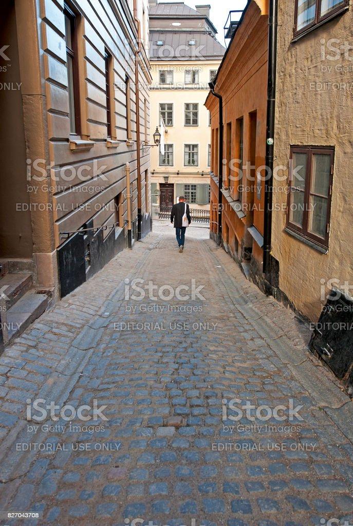 Lone walk in Gamla Stan, Stockholm, Sweden stock photo