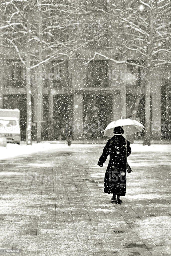 lone woman walking stock photo