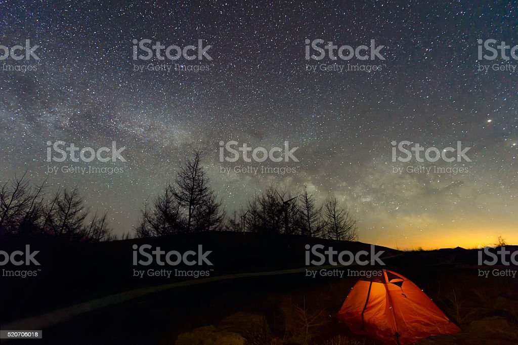 Loneley Camper under Milky Way near the forest stock photo