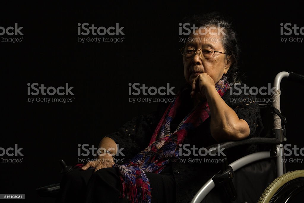 Loneliness elder woman stock photo