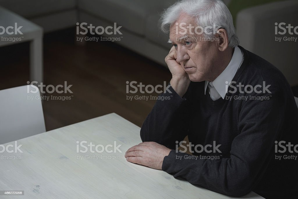 Loneliness in old age stock photo