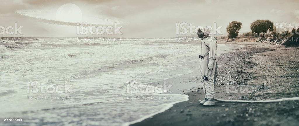 Lonely astronaut on the beach stock photo