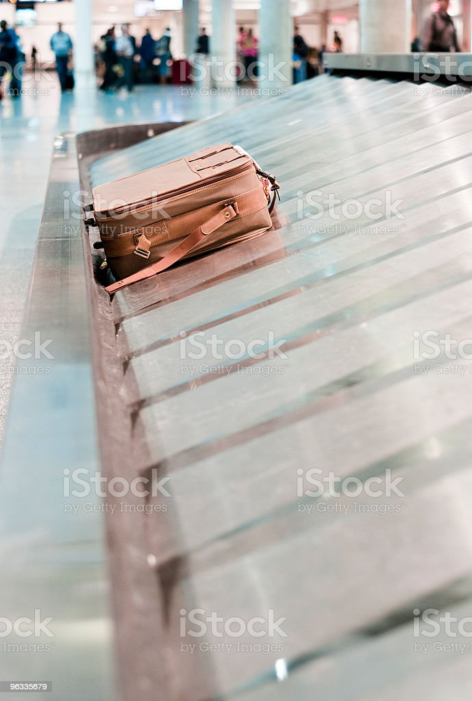 Lonely baggage left in airport band with blurred background royalty-free stock photo