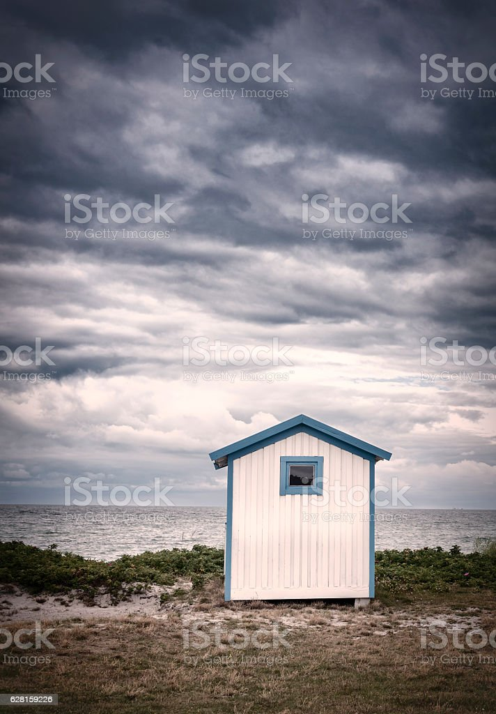 Lonely bathing hut on the beach stock photo
