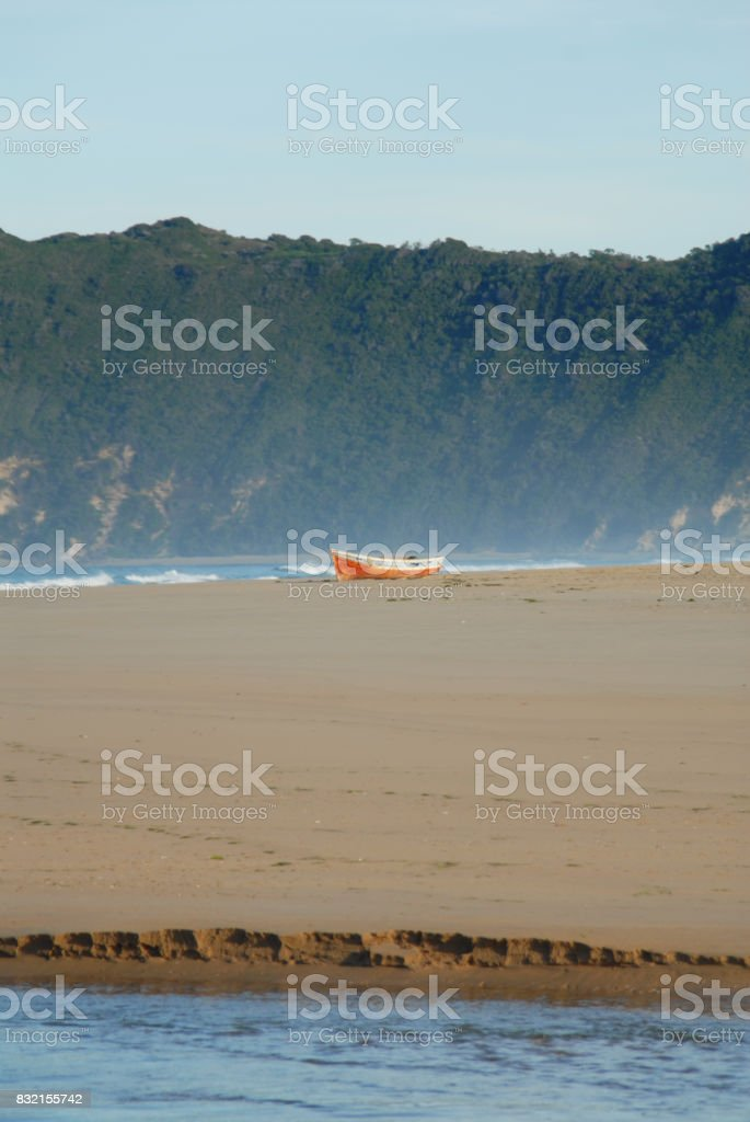 Lonely Beach boat Garden Route scene with river stock photo