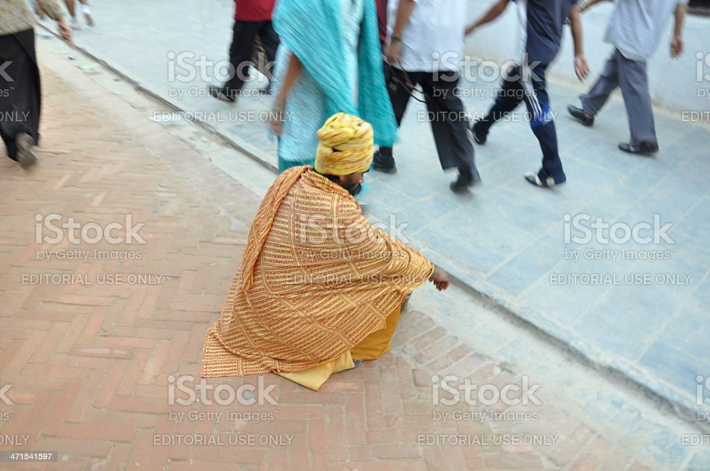lonely beggar upon a religious holiday in Nepal royalty-free stock photo