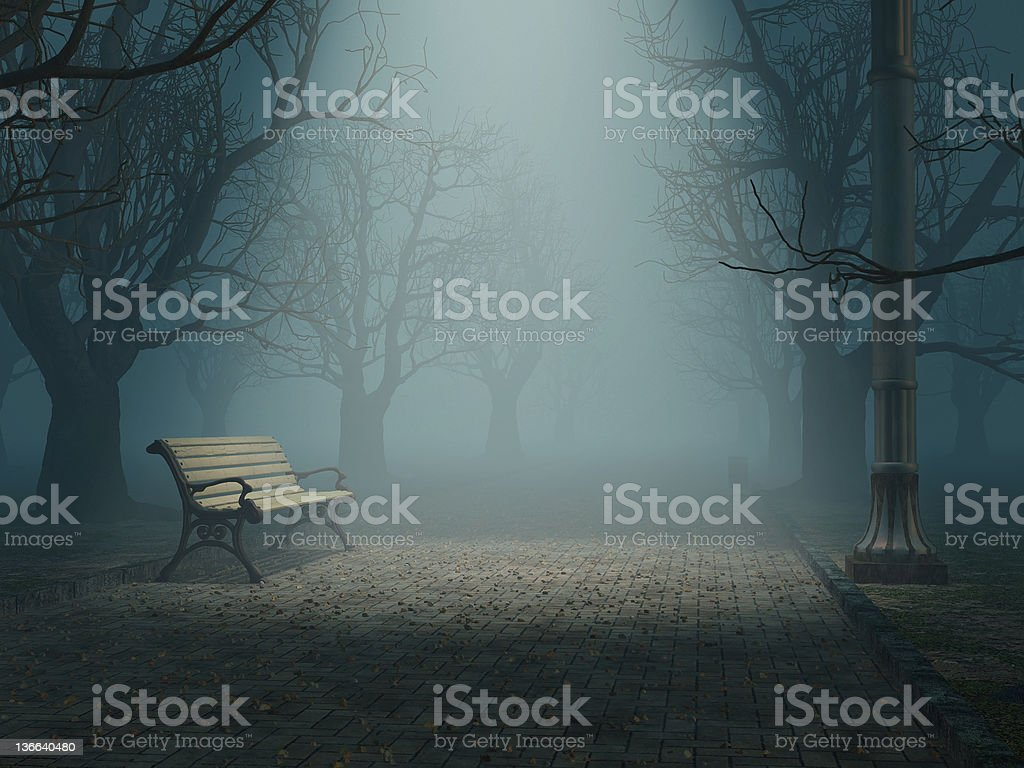 lonely bench in misty park stock photo
