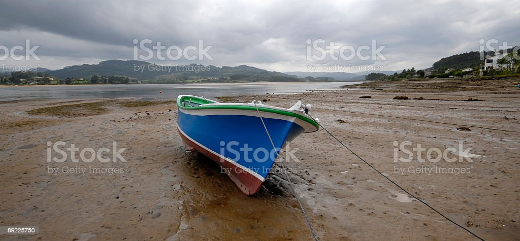 Lonely boat at the beach. Landscape stock photo