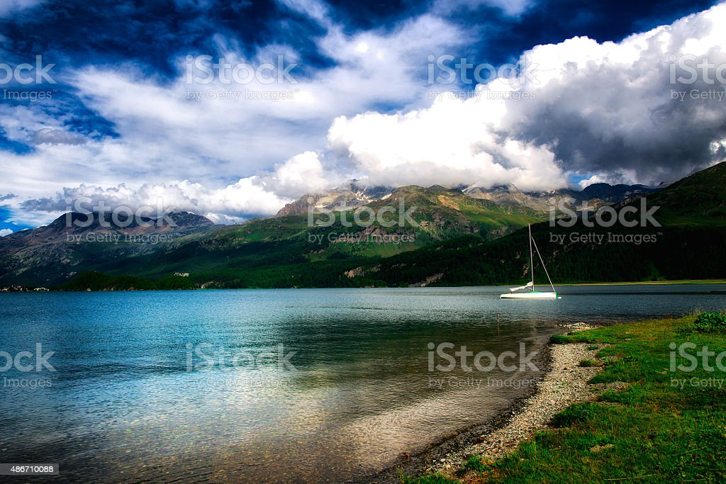 Lonely boat in an alpine lake in the Swiss Alps stock photo