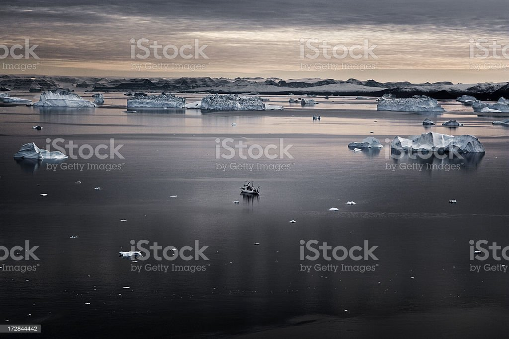 Lonely boat in greenland royalty-free stock photo