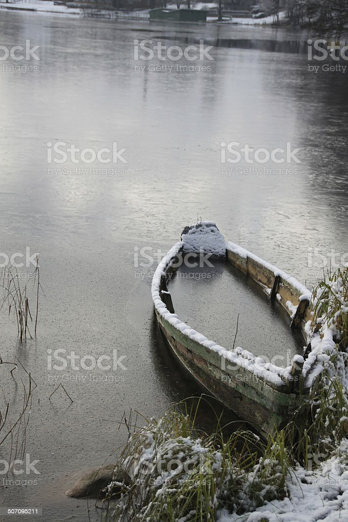 Lonely boat in the winter in Trakai, Lithuania stock photo