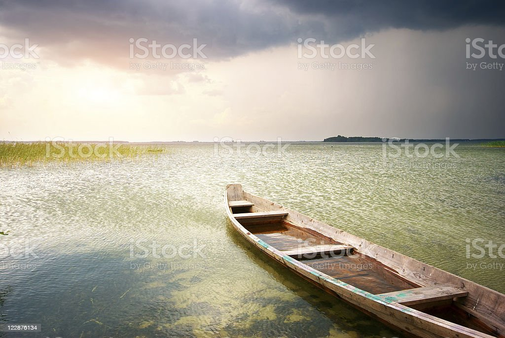 Lonely boat on lake royalty-free stock photo