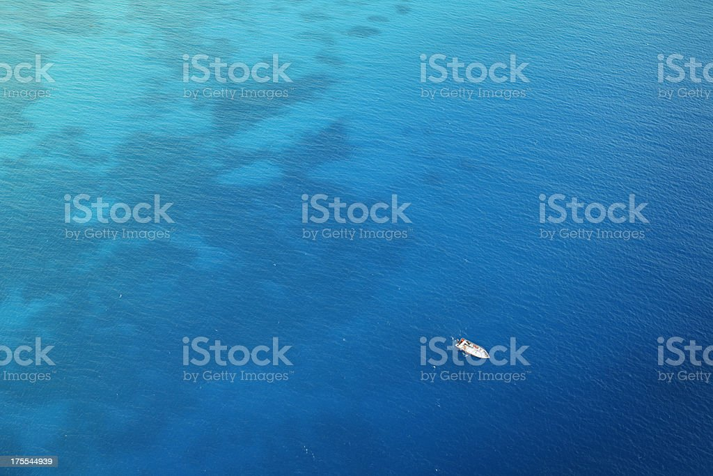Lonely boat on the sea stock photo