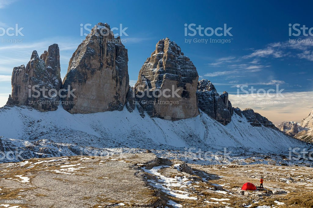 Lonely camper looking at  the three Pinnacles in wintertime stock photo