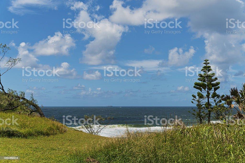 Lonely Cargo Ship on Horizon royalty-free stock photo