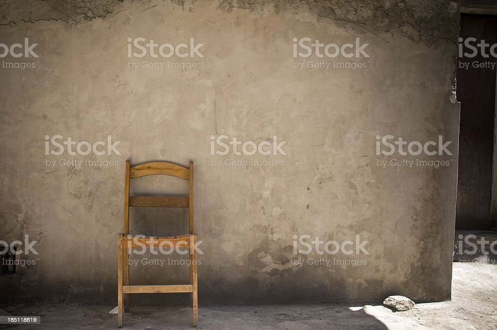 Lonely Chair on grungy wall royalty-free stock photo