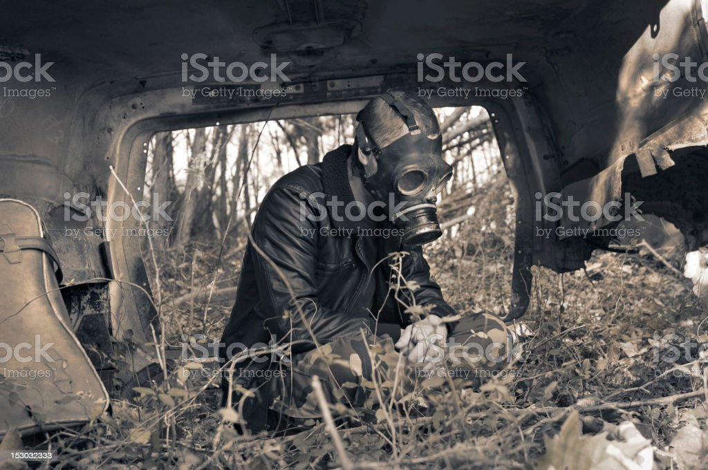 Lonely Character Finds Saftey in a Bizarre Polluted Future stock photo