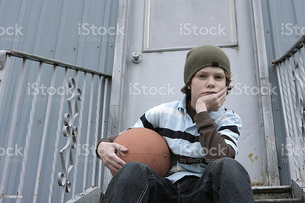 Lonely Child with Basketball royalty-free stock photo