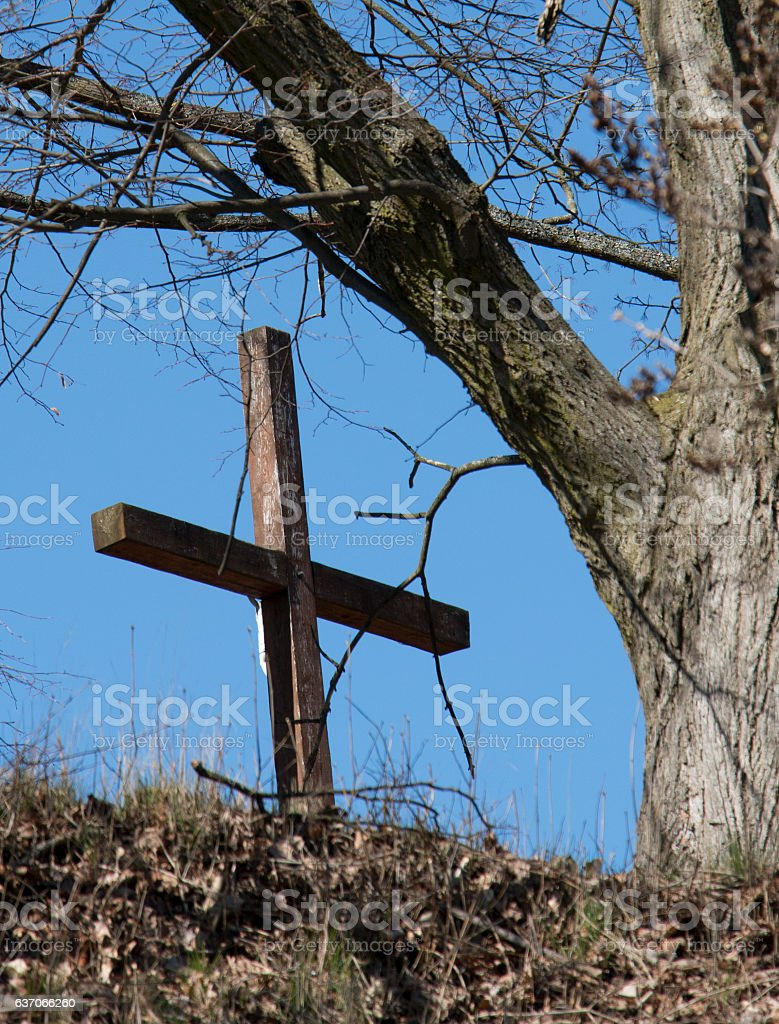 Lonely cross on the hill stock photo