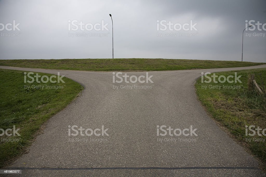Lonely crossing where three roads come together stock photo